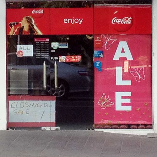 Angle Limited funny signage Coca-Cola shop front with Ale sign