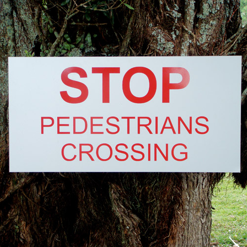 Confusing stop pedestrians crossing sign
