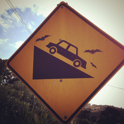 Creative steep gradient road sign on Waiheke Island, New Zealand